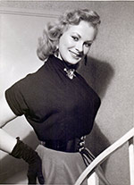 Sabrina in her six-button belt and black gloves