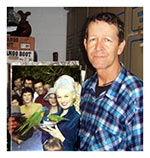 Fred Lang Jr holds a picture of Sabrina (taken by his father) at a Gold Coast bird santuary.