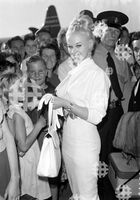 September 14, 1959. Brisbane, QLD. Movie actress Sabrina being met by fans after she arrives at Eagle Farm airport