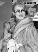 Sabrina as Dame Edna with specs, fur, gloves